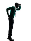 African black man standing tiptoe looking away silhouette Royalty Free Stock Images