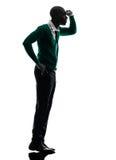African black man standing tiptoe looking away silhouette Royalty Free Stock Photo