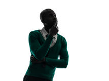 African black man thinking pensive  silhouette Stock Photo