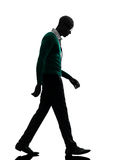 African black man walking looking down sad silhouette Royalty Free Stock Images