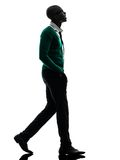 African black man walking looking up silhouette Stock Image