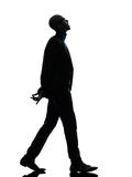 African black man walking looking up smiling silhouette Stock Images