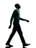 African black man walking looking up smiling silhouette silhouet. One african  black man walking looking up smiling  in silhouette studio on white background Stock Photo
