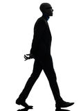African black man walking toothy smiling  silhouette Royalty Free Stock Images