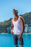 African black man wearing white vest and blue short jeans Stock Image
