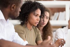 African teacher team leader speaking explaining online work to employees stock photo