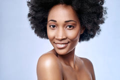 African black model flawless skin. Portrait of beautiful black african model smiling in studio with smooth complexion flawless skin, skincare beauty concept Royalty Free Stock Images