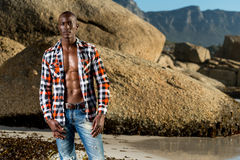 African black model with six pack in unbuttoned checkered shirt Royalty Free Stock Image