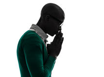 African black muslim man praying silhouette Royalty Free Stock Images