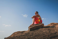 African black woman on a natural coastal rock Royalty Free Stock Photography