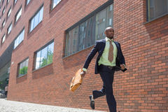African black young businessman running in a city Stock Image