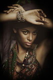 African black young woman beauty portrait with turban studio sho Royalty Free Stock Image