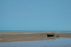 African boat on the beach. Boat on the beach at low tide in Tanzania Royalty Free Stock Images