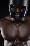 African boxer wearing protective head guard Royalty Free Stock Photography