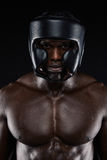 African boxer wearing protective head guard Stock Photo