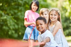 Free African Boy And Friends In Tug Of War Royalty Free Stock Image - 109982356