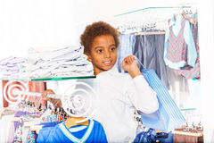 African boy with bag standing in the shopping mall Royalty Free Stock Photos