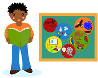 African boy with a book near the school boards, school subjects Stock Image