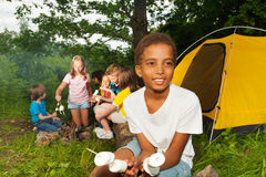 African boy camping and holding marshmallow Royalty Free Stock Image
