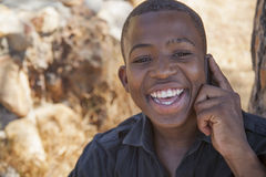 African boy on cell phone. Outside Royalty Free Stock Photo