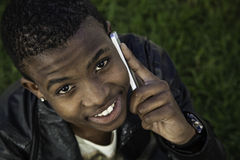 African boy on cell phone outside Royalty Free Stock Photography