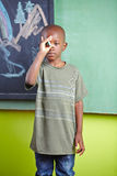 African boy with chalk in front Stock Photos