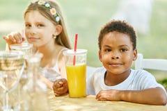 African boy is drinking fresh orange juice royalty free stock photo