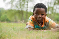African boy in the grass Stock Image