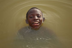 African Boy In River Royalty Free Stock Image