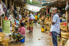African market. Teenager on the road within the market of Arsha, Tanzania, Africa Stock Image