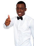 African boy in party-wear gesturing thumbs-up Stock Photo
