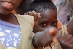 African boy pointing at camera Royalty Free Stock Photos