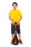African boy standing holding skate board Stock Photos