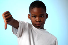 African boy thumbs down sign Royalty Free Stock Photography