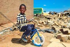 African Boy in a Tornado damaged Township. Johannesburg, South Africa - October 04 2011: African Boy in a Tornado damaged Township royalty free stock images