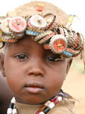 African boy wearing bottle caps Royalty Free Stock Images