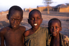 African boys. Three young african boys smiling at the camera stock images
