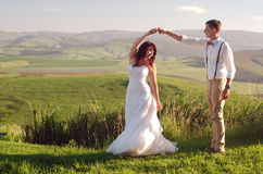African bride and groom landscape. Bride and groom outside garden wedding with African Natal Midlands mountain scenery background Stock Photo
