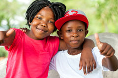 African brother and sister doing thumbs up. Stock Images