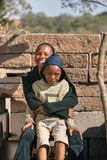 African brothers in the back of the house. In the village, Botswana stock images