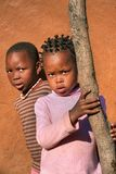 African brothers in the back of the house. In the village, Botswana stock image