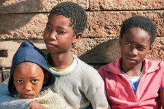 African brothers in front of the house. In the village, Botswana royalty free stock image