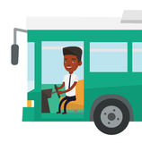 African bus driver sitting at steering wheel. Stock Images