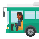 African bus driver sitting at steering wheel. Royalty Free Stock Images