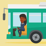 African bus driver sitting at steering wheel. Stock Image
