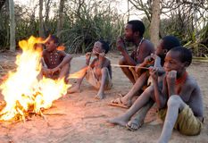 African bushmen by the fire Royalty Free Stock Photo