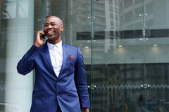 African business executive walking and talking on cell phone Royalty Free Stock Photography