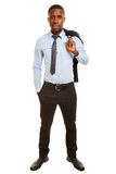African business man carrying jacket Royalty Free Stock Photos