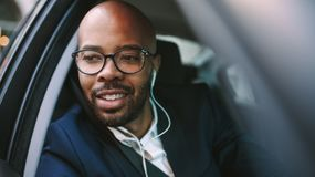 African business man driving car to office stock photography