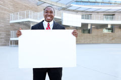 African Business Man Holding Sign Royalty Free Stock Photography